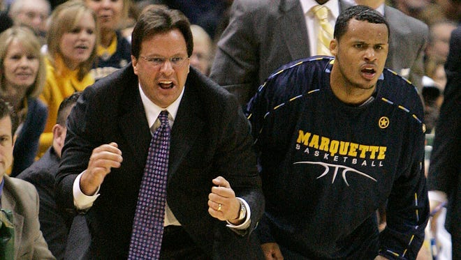 Marquette coach Tom Crean (left) and Dominic James cheer from the bench during a game Jan. 26, 2008, in Milwaukee.