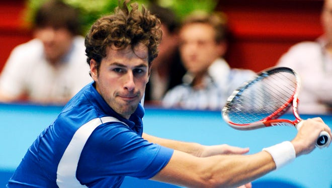 Robin Haase of the Netherlands returns the ball to Jo-Wilfried Tsonga of France during their semi final match at the Erste Bank Open tennis tournament in Vienna, Austria, Saturday, Oct. 19, 2013. Haase won the match with7-5 and 7-6.