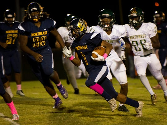 Gus Antoine Jr., 1, runs the ball during Northeast's game against Northwest.