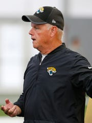 Pat Flaherty talks to his players with the Jaguars in 2018.