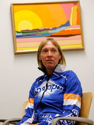 Cathy Tibbetts talks about her beginner triathlon class on Tuesday during an interview at San Juan College in Farmington.