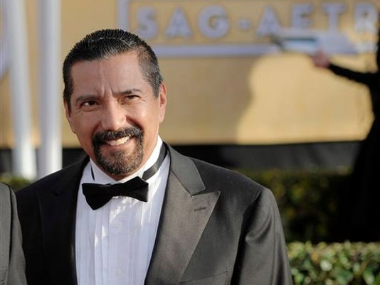 """FILE - This Jan. 27, 2013 file photo shows actor Steven Michael Quezada at the 19th Annual Screen Actors Guild Awards in Los Angeles. Quezada is jumping in a race for a heated county commissioner seat in Albuquerque. Quezada, who played DEA agent Steven Gomez in the hit AMC-TV series  """"Breaking Bad"""", said Monday, July 20, he will announce this week that he will run for the Bernalillo County Commission. (Photo by Chris Pizzello/Invision/AP, File)"""