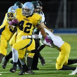 Capes 42 Kolbi Wright carries the ball as Cape Henlopen (yellow) hosted Indian River (white) in varsity football Friday, Sept. 25.
