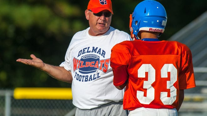 Delmar head coach David Hearn instructs a back at Delmar during a preseason scrimmage.