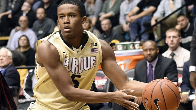 Basil Smotherman of Purdue looks to pass against Grambling State.