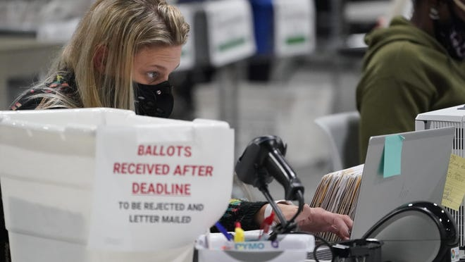 Votes are counted at the Gwinnett County Voter Registration and Elections Headquarters on Friday in Lawrenceville.