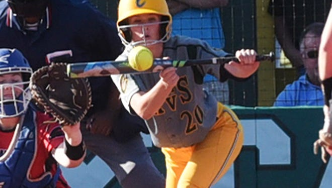 Calvary's Bryee Kelley squares to bunt in the Lady Cavaliers' game against Evangel Friday evening at Calvary.