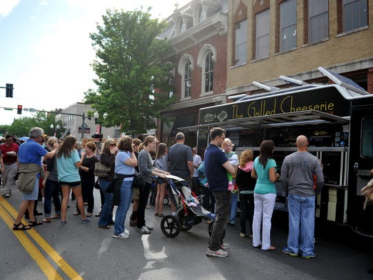 A long line forms at the Grilled Cheeserie during the