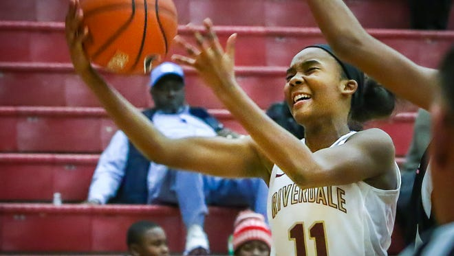 Riverdale's Aislynn Hayes goes up for a layup during Thursday's State Farm Classic.
