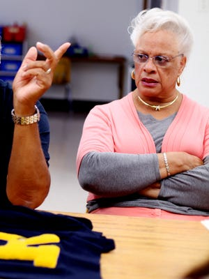 Jeanie McCutcheon, whose husband, Gene, graduated from Rosenwald High School in Waynesboro sits in as other alumni share memories on Wednesday, Nov. 2, 2016.