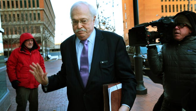 File: Pathologist Dr. Michael Baden waves off media questions as he arrives to testify before the grand jury concerning the Michael Brown shooting at the Buzz Westfall Justice Center in Clayton, Mo., on Thursday, Nov. 13, 2014.