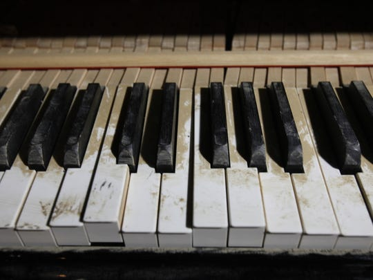 The keys of the stage piano are mud-stained during