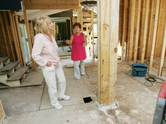 Jeannie Seely, left, walks through her neighbor Carolyn