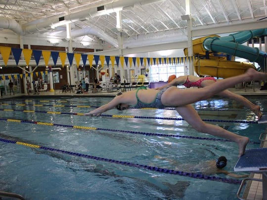 Hanna Petersen of Basking Ridge and Kate Alexy of Chester, both  members of Somerset Hills YMCA's Swim Team and Saturdays in Motion volunteers, swam to raise funds for Saturdays in Motion.