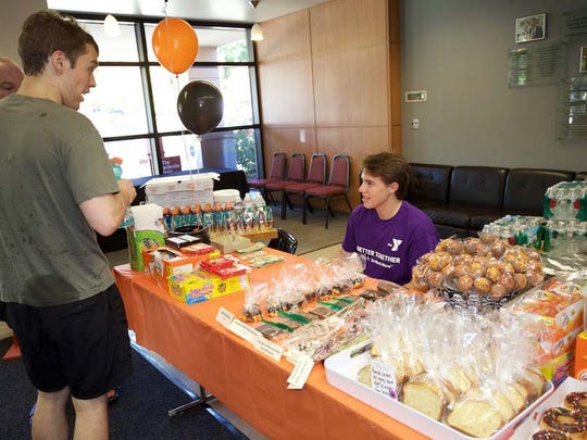 Andrew Larkey of Bridgewater selling refreshments at the Saturdays in Motion fundraiser. The fundraiser supports Saturdays in Motion, a recreational program for children with autism and their families. Brian Rans of Jersey City and Art Raynes of Basking Ridge are also pictured.