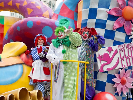 Detroit's parade includes a group of more than 170 clowns who hand out beads and humor along the way.