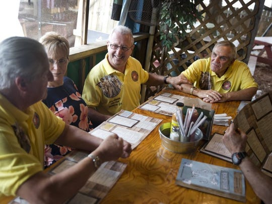 After recreating the photo on Cinnamon Beach the four, plus Dennis' wife Joanne, all went out to lunch to tell old war stories and to catch up on each other's personal lives after combat Saturday, April 23, 2016 in Palm Coast, Florida. The four haven't all been in the same place since they were shipped off to fight in Vietnam.