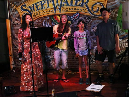 From left, professional singer Elizabeth Canino of Naples performs with friends Devon Meyers of Naples, Bella Powell, 9, of Delray Beach and Brett Queener of Naples at South Street City Oven and Grill on Thursday, June 2, 2016.