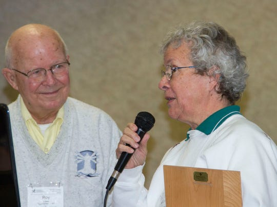 Roy and Charlotte Lukes accept the Samuel D. Robbins Lifetime Achievement Award from the Wisconsin Society for Ornithology last May.