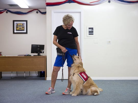 """Jan Napolitano, trainer at PAWS Assistance Dogs of Naples, works with Hope, a future service dog, at the PAWS facility Thursday, July 2, 2016 in Naples, Fla. Jan has worked with Hope since she was eight weeks old and is bittersweet about seeing her leave for her permanent home. """"After two years she's just a part of me,"""" Jan said. """"I know she's gonna love him and he's gonna love her."""""""