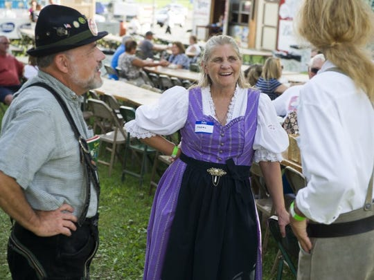 Willie Taylor, of Evansville, and (from left), Naomi Cox and Dennis Havel, both of Mount Carmel, Ill., joke around during the German festival.