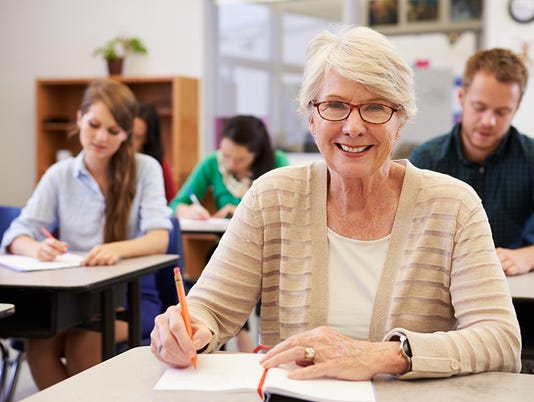Happy senior woman at an adult education class looking