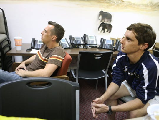 Paul Thurman (left) and Andrew Lugo watches the presidential