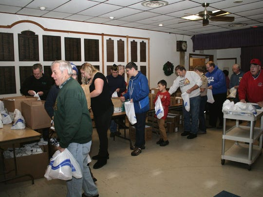 Some 80 volunteers were on hand Saturday to help the Plymouth-Ann Arbor Elks pack Christmas presents for area veterans.