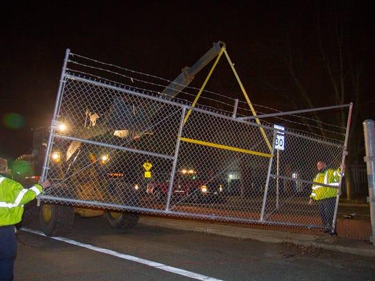 The fence at Fort Monmouth is taken down to open the