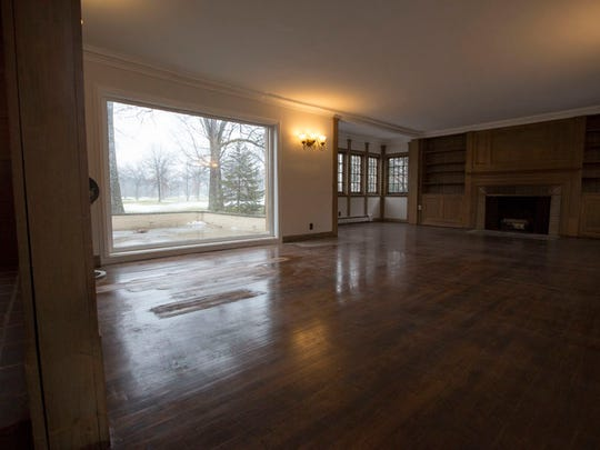 The living room of this home on the Detroit Golf Club looks out on150 square foot frontage.