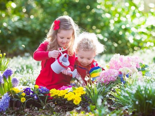 636329670753068693-bigstock-Kids-Planting-Flowers-In-Bloom-120456704.jpg
