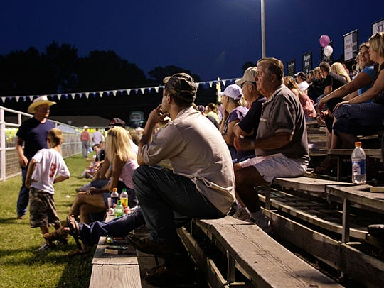 The crowd watches at a previous Ozark Booster Club