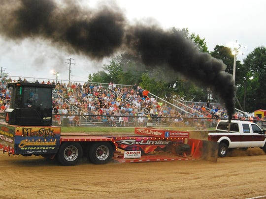 A truck competes in a prior year's Battle of the Bluegrass Truck and Tractor Pull at the Boone County 4H & Utopia Fair. This year's high horsepower pull will be at 7 p.m. Saturday, Aug. 4.