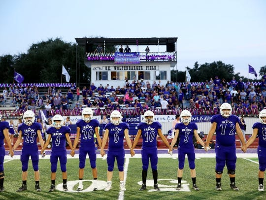 The Irion County football team stands before a game at O.K. Wolfenbarger Field in Mertzon.
