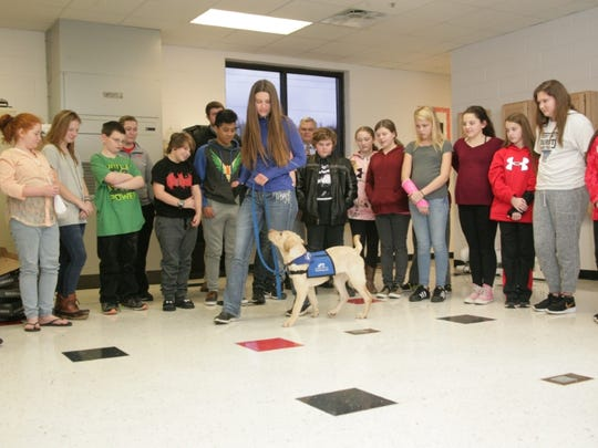 Trainer Maxine Knoepfel introduces Arthur to students