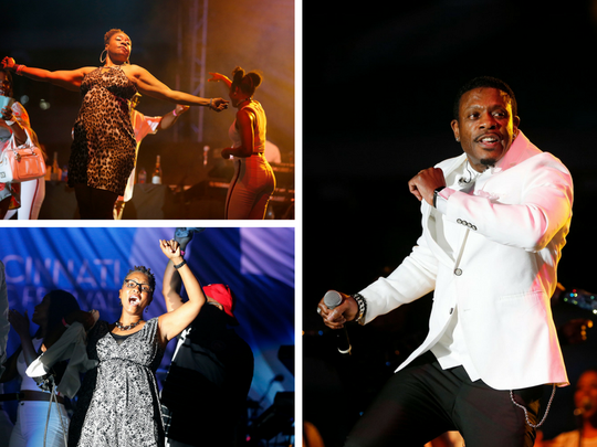 Audience members take the stage during Keith Sweat's performance at Cincinnati Music Festival.