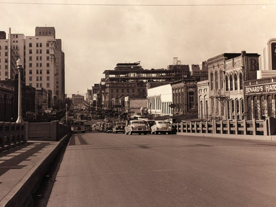 Texas Street Bridge and the construction of the Petroleum Tower in 1957.