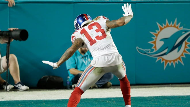 New York Giants wide receiver Odell Beckham dances after scoring a touchdown against the Miami Dolphins on Monday, Dec. 14, 2015, in Miami Gardens, Fla.