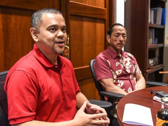 Sen. Dennis Rodriguez Jr., left, is seated with Legislative