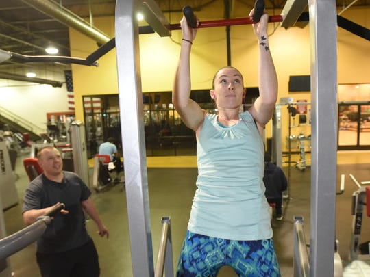 """""""I come every day. Change doesn't start at the beginning of the year,"""" said Kelley Dame, who showed up at Defined Fitness in Farmington on New Year's Day with her husband, Daniel Dame, to work out."""