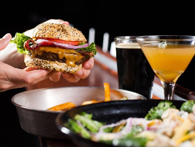 The Ozark Prime Burger with a stout beer, left, and