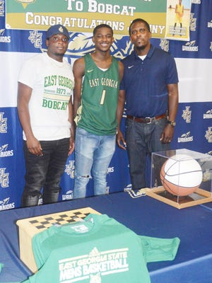 Johnny Kittles poses with his JCHS coaches after signing a scholarship to East Georgia State College.
