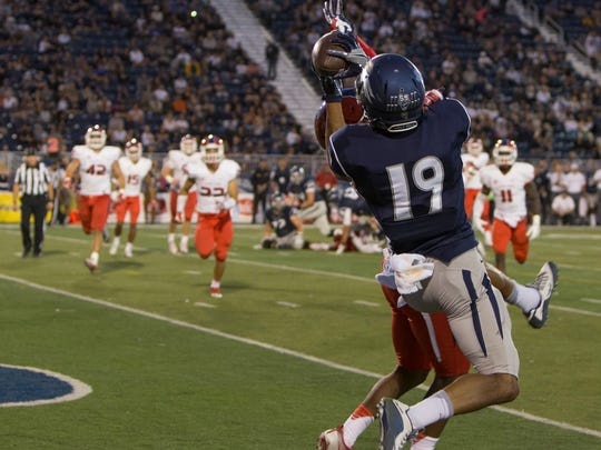 Nevada's Wyatt Demps hauls in one of his three touchdown catches against Fresno State.