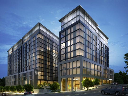 A rendering of RISE at Riverfront Crossings, built by CA Ventures at the site of the former St. Patrick's Catholic Church parish hall, shows its 15-story residential building and a 14-story hotel and mixed use building.