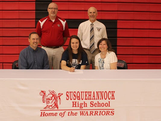 Abbey Barnhart, bottom center, is featured with her parents, Kevin and Sue Barnhart. Also pictured, in the back row, are, from left: coach Rob Marrison and athletic director Chuck Abbott.