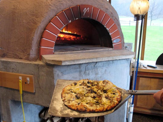 Newer outlets for pizza in Wisconsin are farms that serve pizza in warmer weather, usually baked outdoors and made with ingredients from the farm or neighborhood. This is the oven at Suncrest Gardens Farm, near Cochrane in Buffalo County.