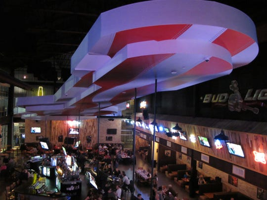 In country music artist Toby Keith's I Love This Bar and Grill is a giant guitar and performance stage.