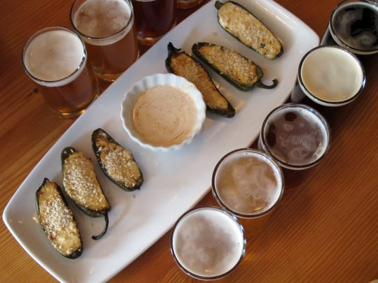 Brewery Poppers, at Appleton Beer Factory, are a mix of white cheddar, cream cheese, American Pale Ale and bacon roasted in honey-glazed jalapeno peppers.