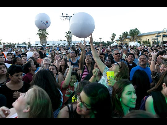 The crowd react as CIVX performs during Tachevah: A Palm Springs Block Party held at the Spa Casino parking lot in Palm Springs on Wednesday evening, April 16, 2014.