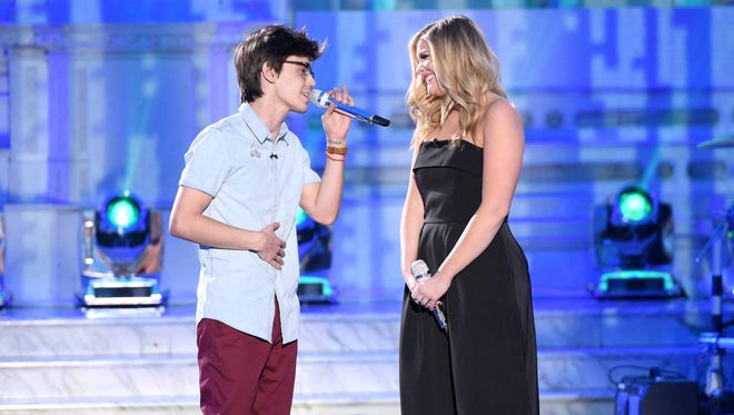 """Mackenzie Bourg and country singer Lauren Alaina sing a duet on 'American Idol."""""""
